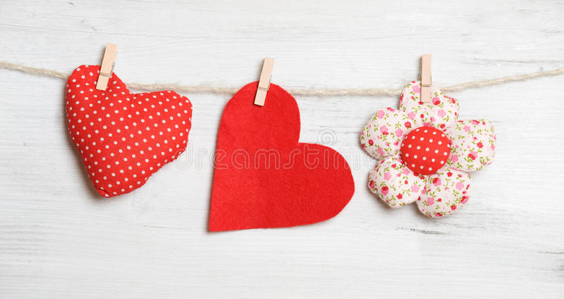 Valentine'S Day. Heart on clothesline on white wooden background stock photo