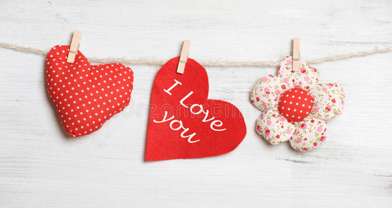 Valentine'S Day. Heart on clothesline on white wooden background royalty free stock images