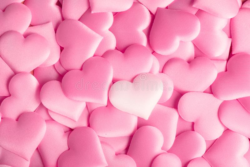 Valentine`s Day. Holiday abstract pink Valentine background with satin hearts. Love royalty free stock image