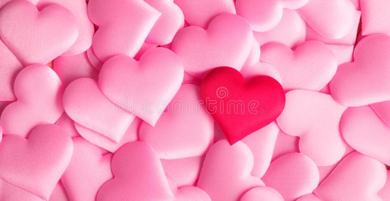 Valentine`s Day. Holiday abstract pink Valentine background with satin hearts. Love concept. Flatlay royalty free stock image
