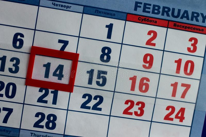 Valentine`s Day holiday is marked in red on the calendar sheet stock images