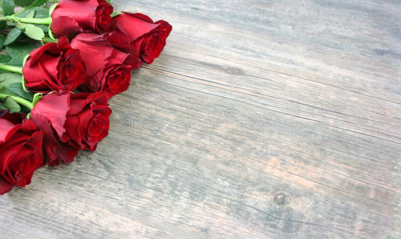 Valentine`s Day Red Roses Over Wooden Background stock image