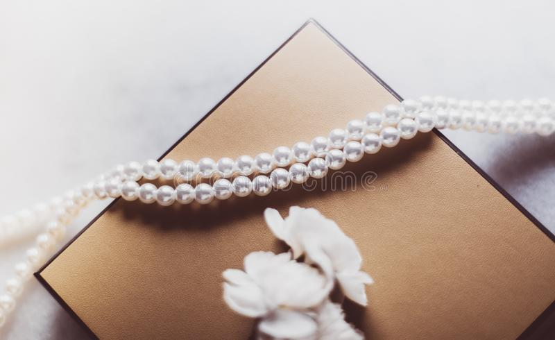 Pearl jewellery in a  golden gift box stock photography