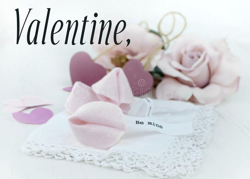 Valentine`s Day image of brightly exposed pink silk roses, cute fortune cookies made of felt and wooden hearts with lace, stock image