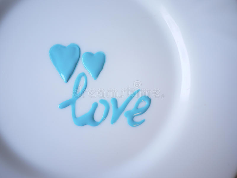 Valentine's Day. The image of the heart on a white plate.Foto can be used for desserts or category creation stock images
