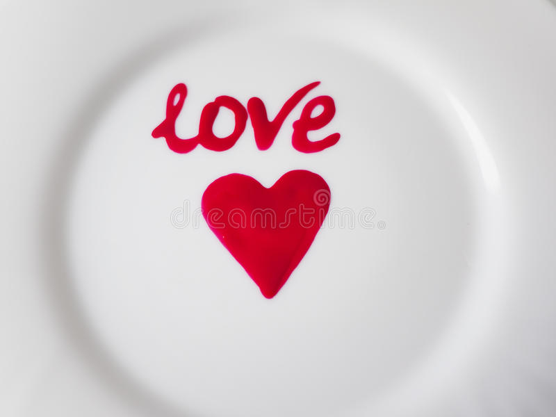 Valentine's Day. The image of the heart on a white plate.Foto can be used for desserts or category creation royalty free stock photography