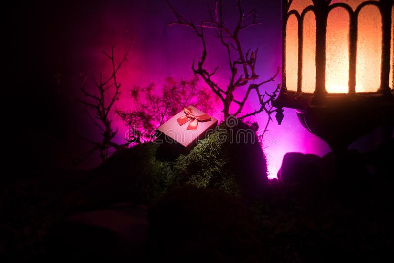 Night wedding ceremony with a lot of vintage lamps and candles on big tree stock image