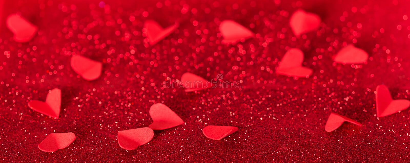 Valentine`s day. Many red hearts on background of shining crystals royalty free stock photos