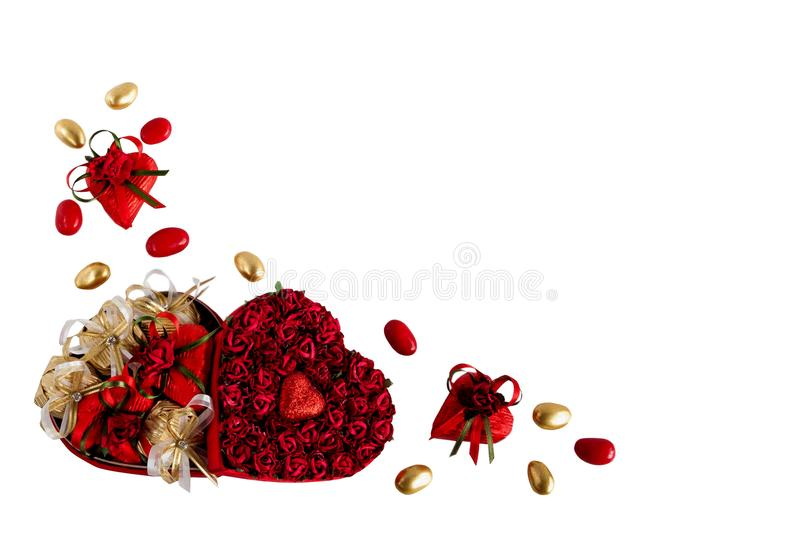 Valentine`s day mix of chocolates in the shape of hearts in the heart shaped box on white background royalty free stock images