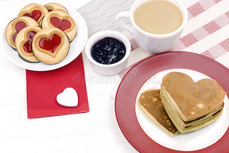 Valentine`s Day. morning breakfast with coffee and pancakes.  royalty free stock photo