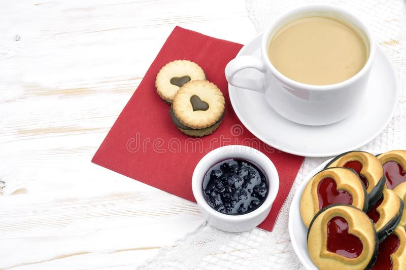 Valentine`s Day. morning coffee with pastries and hearts.  stock photos