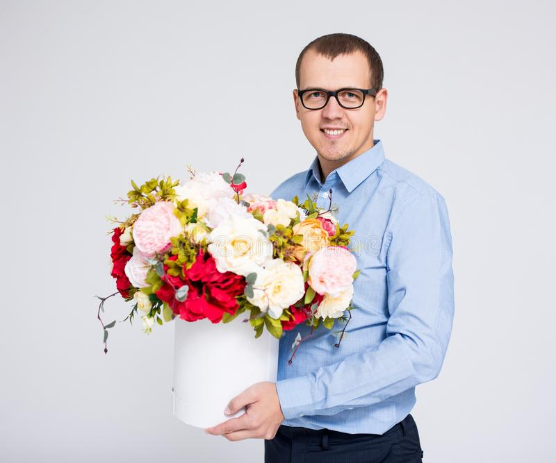 valentine`s day concept - portrait of young handsome man with flowers box stock photos