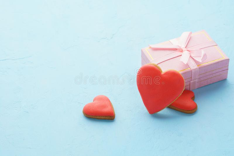 Valentines Day. Pink gift box and red heart shaped cookies. royalty free stock photos