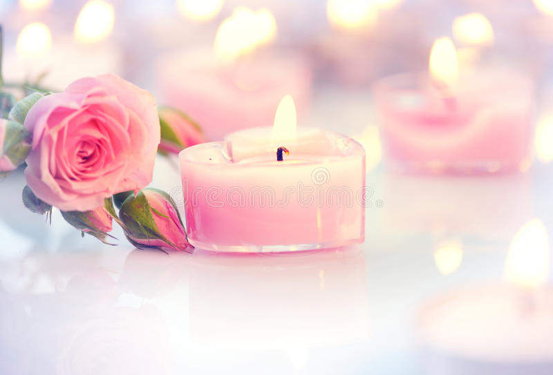 Valentine's Day. Pink heart shaped candles and roses. Valentine's Day. Pink heart shaped candles and rose flowers stock photography