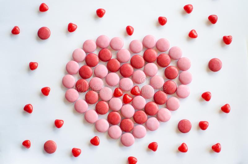 Valentine`s day pink and red heart made of chocolate and candies stock photography