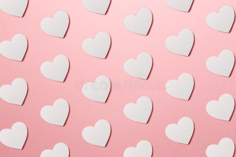 Valentine`s Day postcard. Valentine`s Day Background. Trendy pattern made with paper hearts on bright pink background stock photos