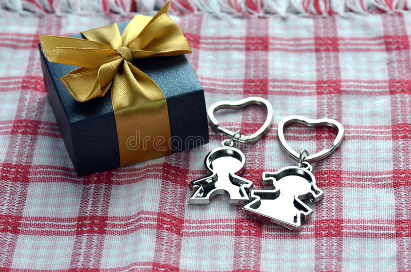 Valentine's Day Present. A pair of love key chains with a present for Valentine's Day stock photos