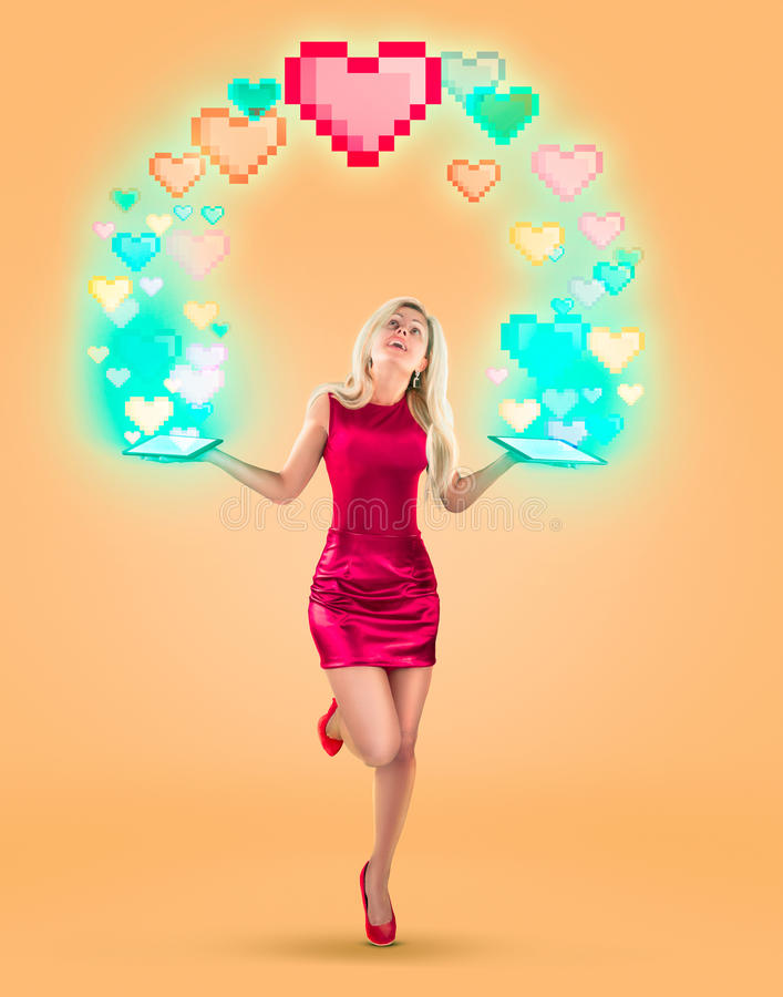 Valentine`s Day red hearts over beautiful blonde woman. On a yellow background. High resolution photo. royalty free stock image