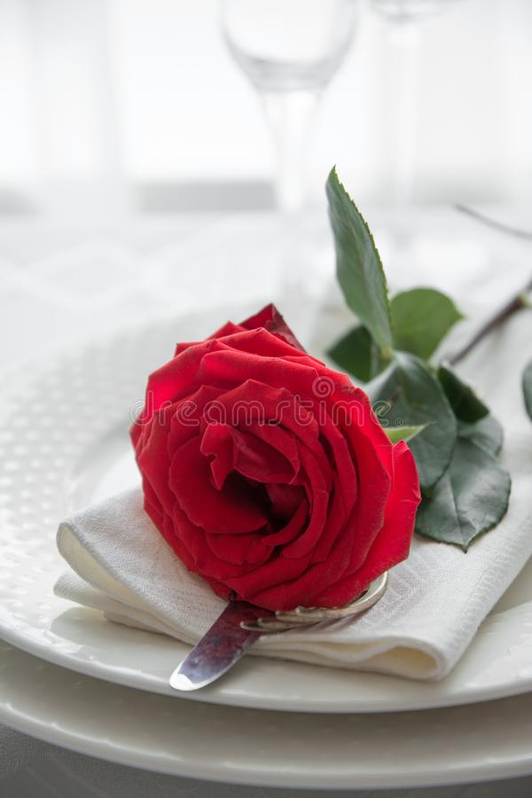 Valentine`s day or romantic dinner with red rose royalty free stock photography