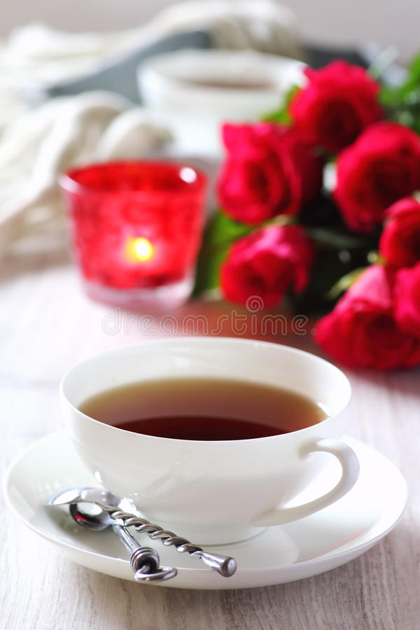 Valentine`s Day: Romantic Tea Party with candle and bouquet of royalty free stock photo
