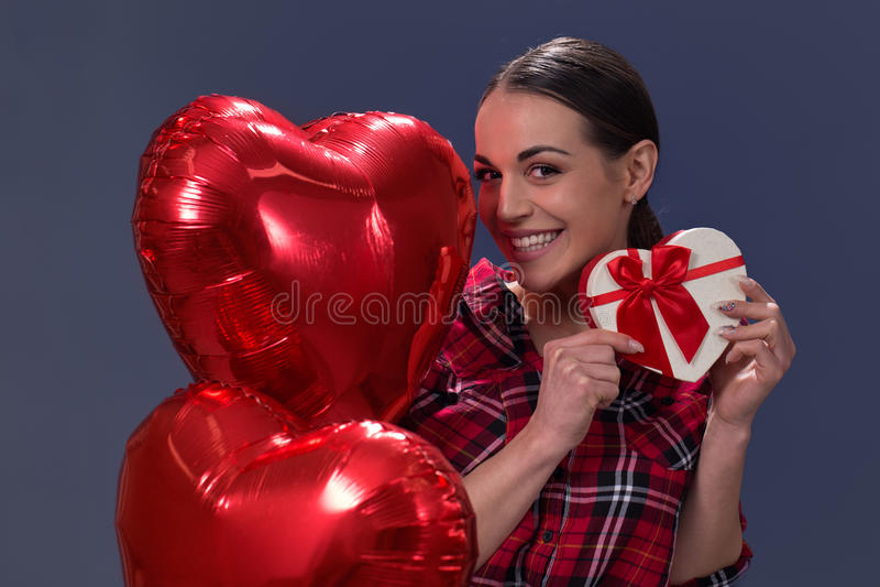 Valentine`s day. model girl holds gift box heart stock images