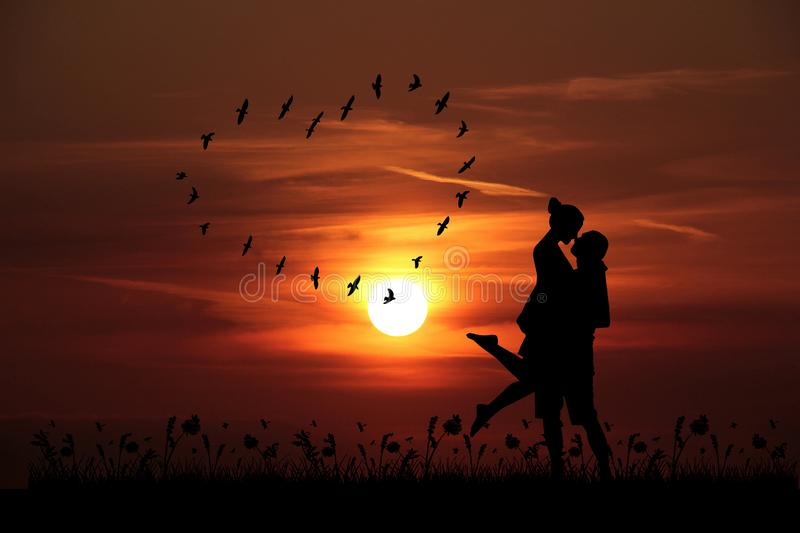 Valentine`s Day sunset background with kissing couple stock images