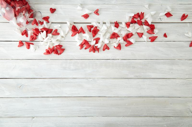 Valentine's Day symbolizing love paper heart in Glass bottle. Valentine's Day symbolizing love Red and white origami hearts in Glass bottle white royalty free stock photos
