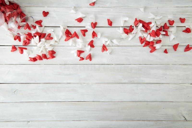 Valentine& x27;s Day symbolizing love paper heart in Glass bottle. Valentine& x27;s Day symbolizing love Red and white origami hearts in Glass bottle white stock photo