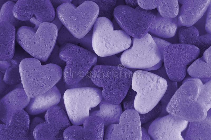 Valentine`s Day. Toning in pantone color - ultra violet. Macro. Valentine`s Day - colored hearts on a white background. Toning in pantone color - ultra violet stock photos