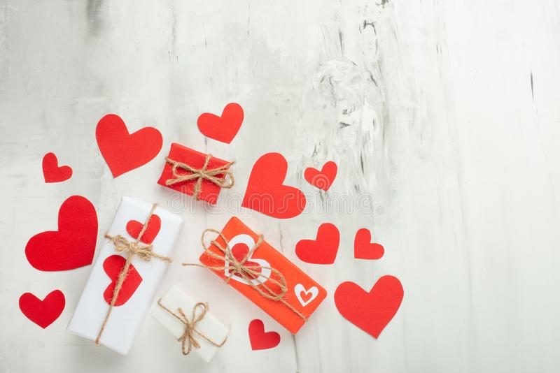 Valentine`s Day. White texture c red hearts on a white background.Flat-lay, top view, copy space royalty free stock photos
