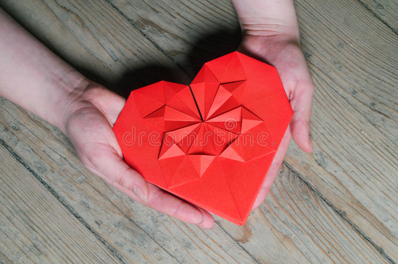 Valentine`s gift, heart in hands stock images