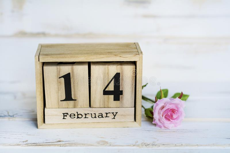 Valentine`s Greeting Card with Rose and Wooden Calendar. Wooden Calendar and Pink Rose for Valentines`s Day stock photos