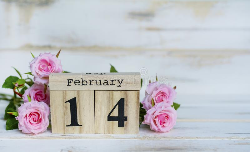Valentine`s Greeting Card with Roses and Wooden Calendar. Wooden Calendar and Pink Roses for Valentines`s Day stock image