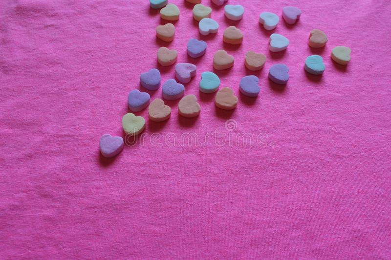 Valentines hearts highlighted bright pink hearts background. Valentine`s hearts with a highlighted bright pink background. Pastels accenting candy hearts royalty free stock image