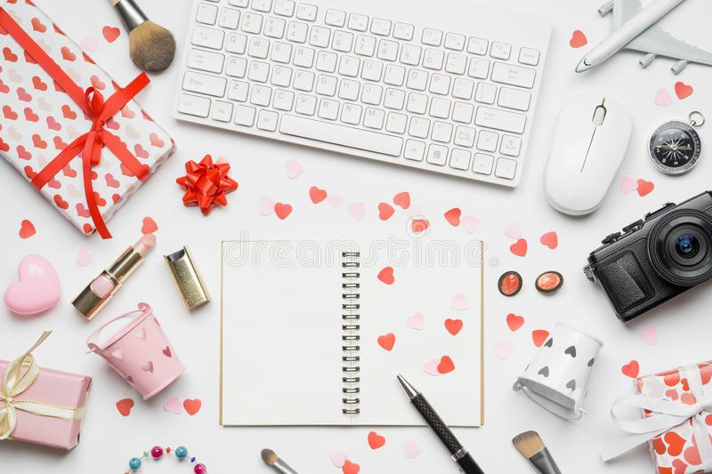 Valentine`s Travel concept, blank space notebook, female cosmetics, gift box, wireless keyboard and mouse on white background.  royalty free stock photography
