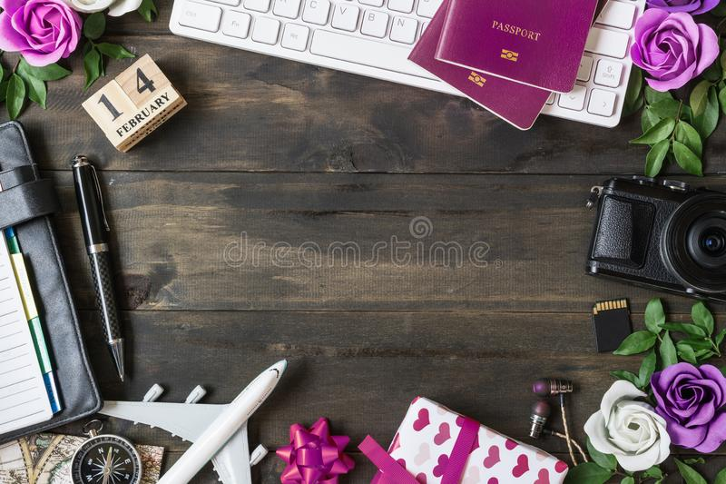 Valentine`s Travel Plan concept. Pc keyboard, passport, camera, sd card, usb devices, notebook, roses, gift box and airplane mode. L. Top view with copy space stock photos