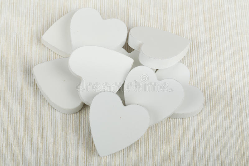 Valentine's wooden hearts. On white fabric , valentine's day, day valentine postcard with space for text stock images