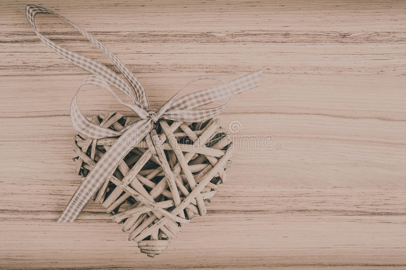 Valentine's wooden hearts on a wooden background in retro color. Valentine's wooden heart on wooden background , valentine's day , day valentine postcard with royalty free stock images