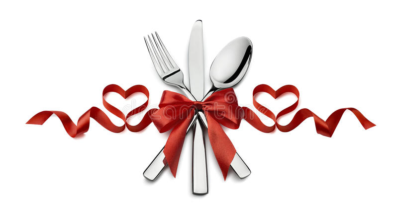 Valentine silverware red ribbon heart restaurant isolated on white background. Valentine fork, knife, spoon, silverware in red ribbon heart shape design element stock photography