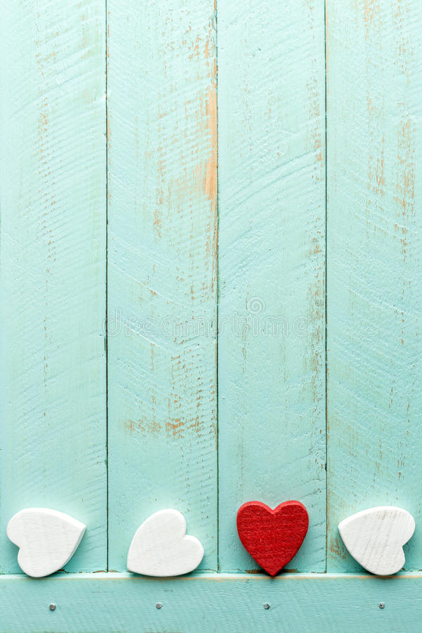 Valentines background. Valentines hearts on wooden background stock photo