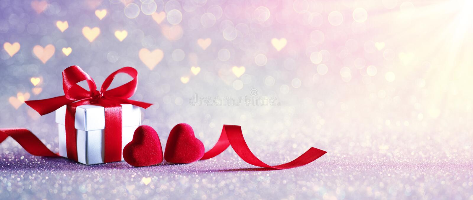Valentines Celebration With Gift box With Defocused Lights. In Shiny Background stock photos