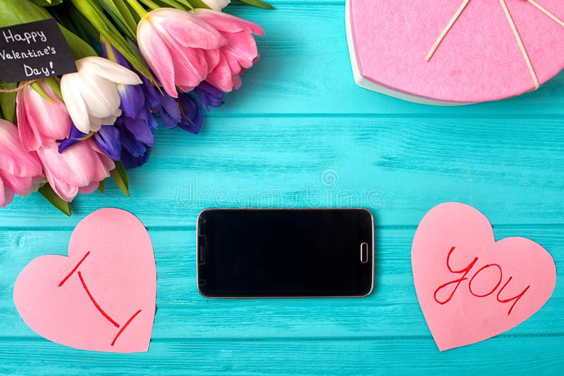 Valentines Day background with bouquet of tulips, a postcard with a confession of love.Happy moments. royalty free stock photo