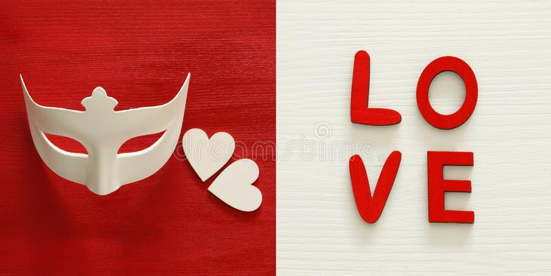 Valentines day background collage. White mask and red rose. Top view. royalty free stock image