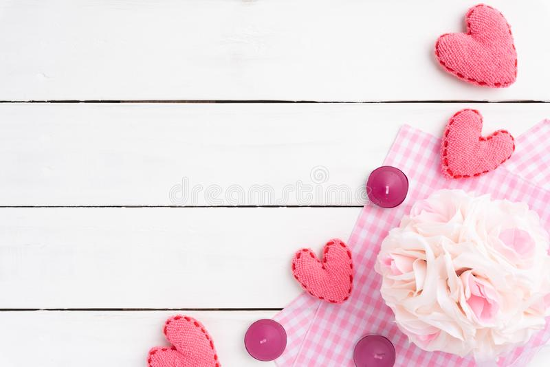 Valentines day background concept. Top view of handmade pink heart and flower stock photography