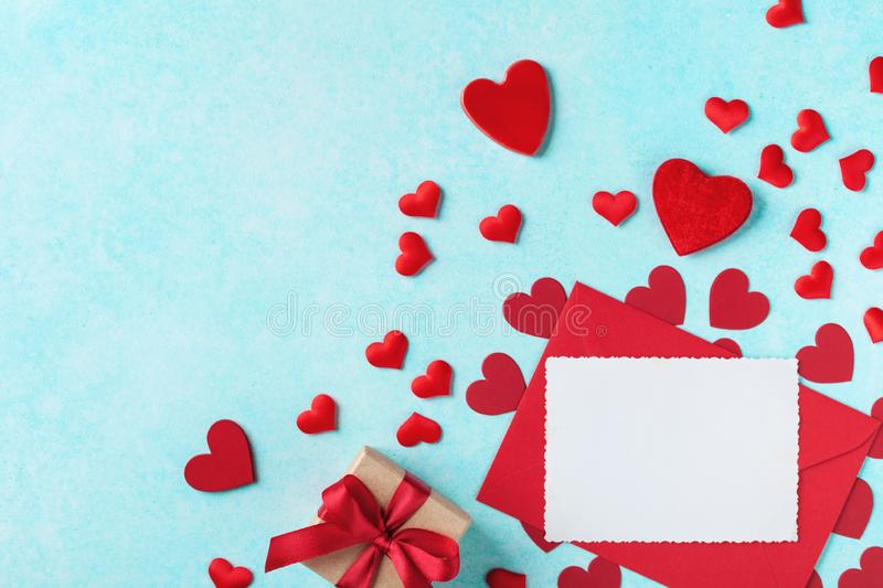Valentines day background. Envelope, greeting card, gift box and red hearts for holiday message royalty free stock photography