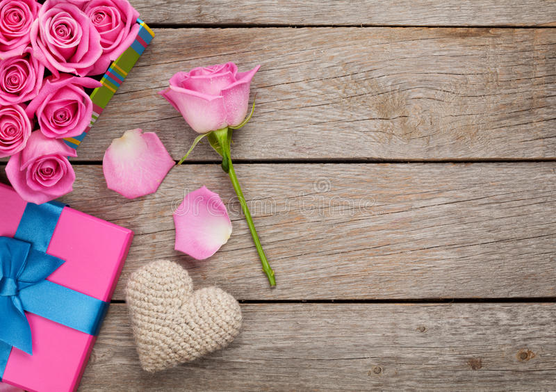 Valentines day background with gift box full of pink roses and h stock photo