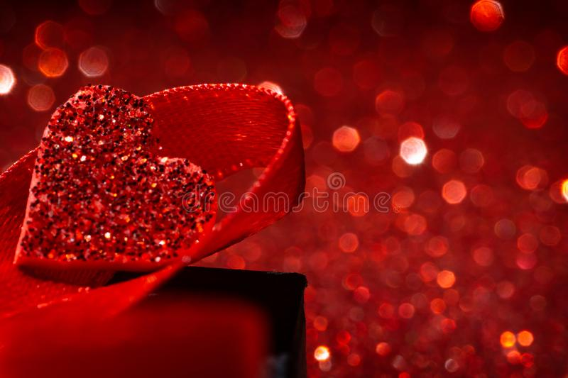 Red bokeh background. Red love concept background with defocused lights. Heart shape royalty free stock photo