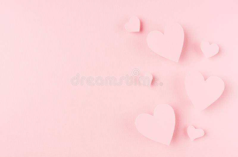Valentines day background with hearts flying on pink paper, copy space. royalty free stock image