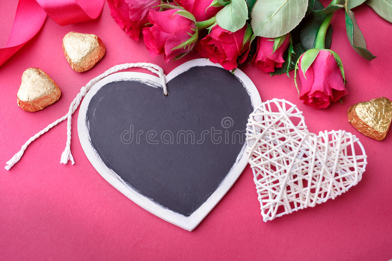 Valentines Day background with hearts and roses. royalty free stock photography