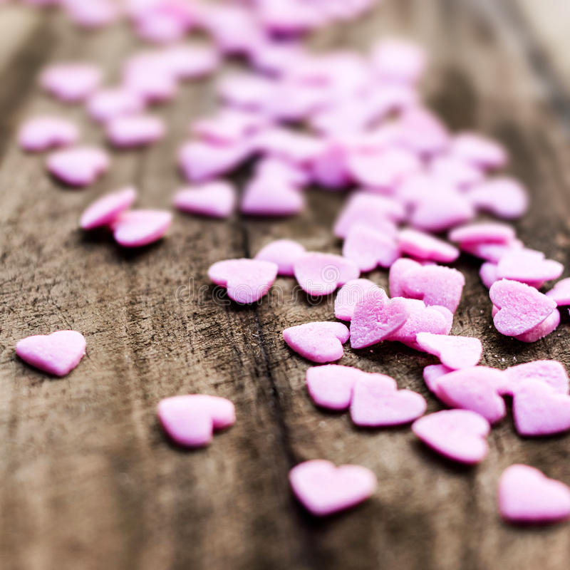 Download Valentines Day Background With Hearts. Sugar Hearts On Wooden Vi Stock Photos - Image: 34076553